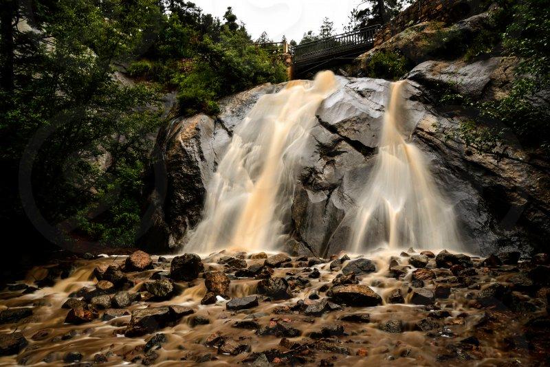 Waterfall landscape storm mud Colorado  photo