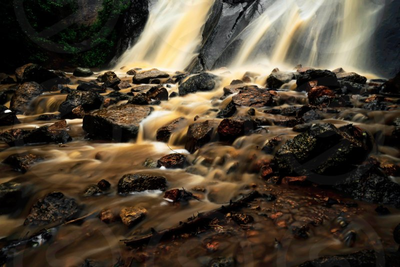 Waterfall somber mud rocks storm Colorado  photo